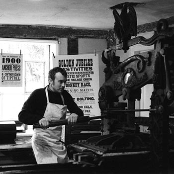 Justin Knopp printing on an early 20th Century Columbian handpress at Wingfield Old College in Suffolk, circa 2003