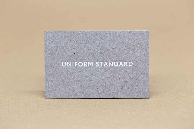 uniform standard business cards white foil stamped recycled greyboard front 750