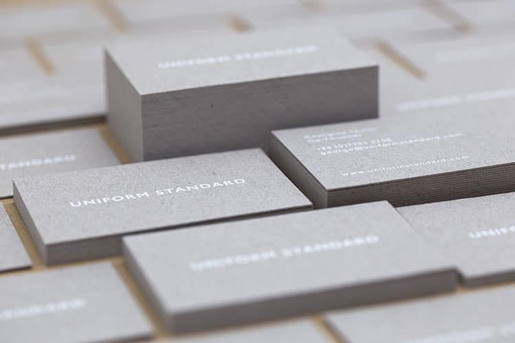 uniform standard business cards white foil stamped recycled greyboard stacks-1 750