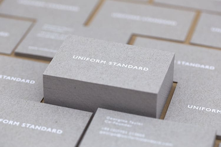 uniform standard business cards white foil stamped recycled greyboard stacks-2 750