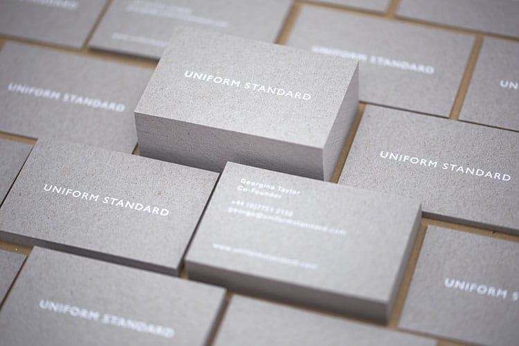 uniform standard business cards white foil stamped recycled greyboard stacks-4 750