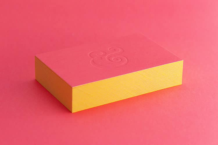 kath-and-company-business-cards-stack-duplexed-letterpress-blind-deboss-ampersand-detail_750